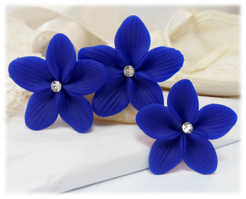 Choose from our many Sexy Hair Accessories, Silk Flower Hair Clips, Hair Pins and Barrettes with Silk Orchids. 90% of our flower hair clips are dyed to match. What it means is that flower clips marked as a part of our *COLOR MATCHED* collection will match exactly with the other flower clips marked as such.